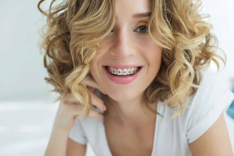 Woman smiling with braces   Orthodontic emergency